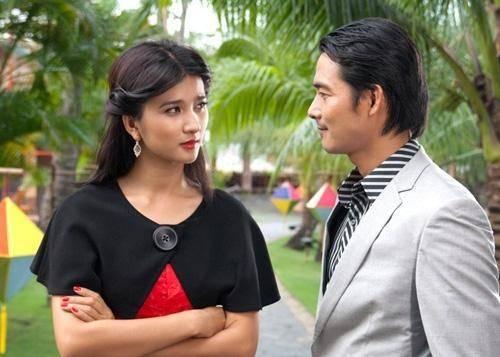 Diễn viên Kim Tuyến và Quách Ngọc Ngoan trong một cảnh quay của Cát nóng